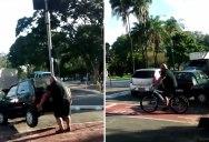 Cyclist Lifts a Car Off a Bike Path, Rides Away a Legend