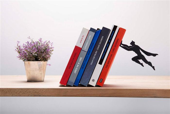 Floating Bookshelves Held Up By Superheroes  by artori design (2)