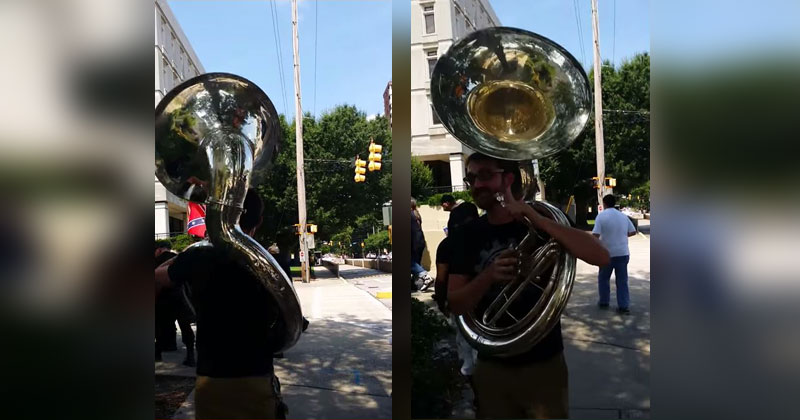 Guy Playing Giant Sousaphone Follows KKK Marchers to a Rally