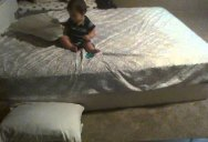 Brilliant Baby Uses Pillows to Soften Landing from Bed to Ground