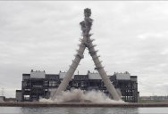 Controlled Demolition Makes Two 500 ft Chimneys Perfectly Collide and Crumble