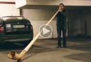 Guy Plays Alphorn Inside Underground Parking Lot