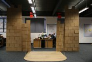 Boss Told Them to Jazz Up Their Cubicle So They Built a Cardboard Castle with Drawbridge