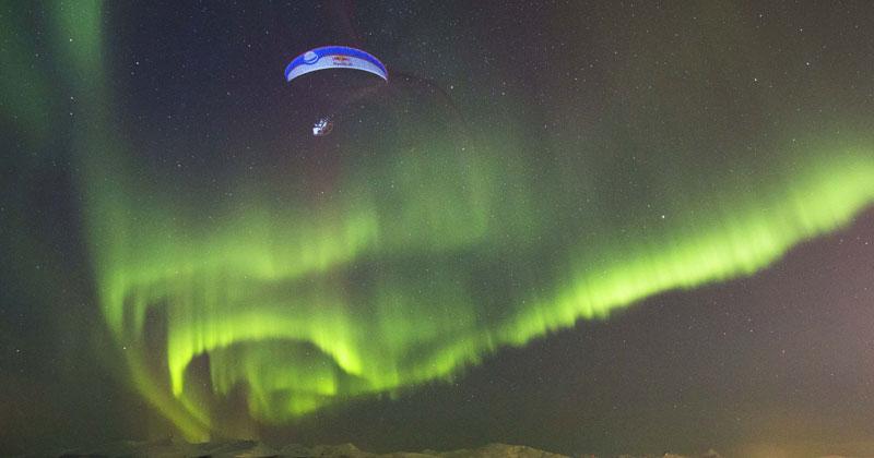 Guy Goes Paragliding Through Aurora Borealis in Norway