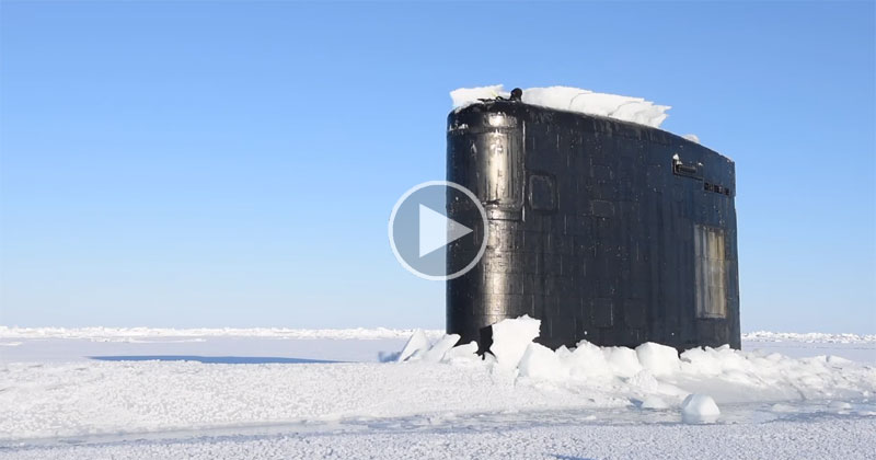 Just a Nuclear Submarine Breaking Through Ice in the Arctic Circle