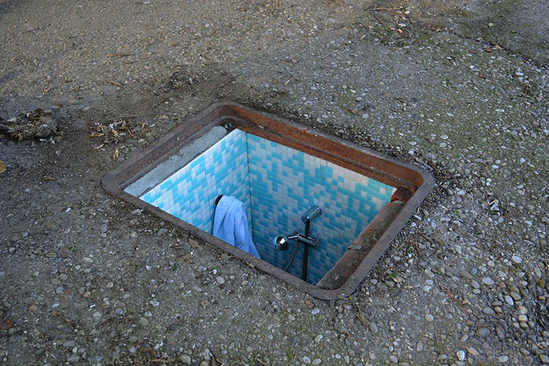 BIANCOSHOCK Installs Miniature Rooms Into Abandoned Manholes in ITALY (1)