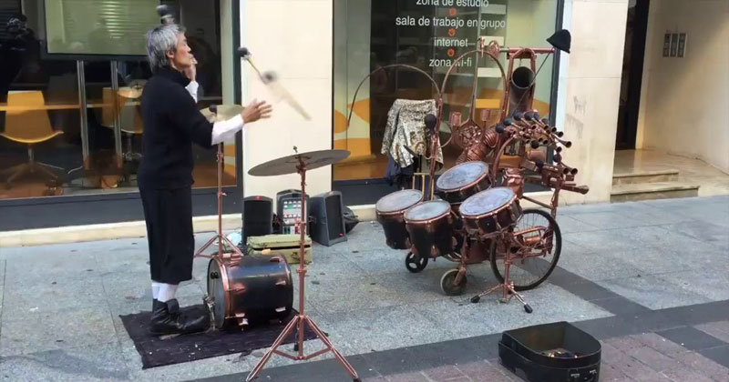 Awesome Street Performer Juggles Mallets and Plays Drums at the Same Time