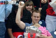 Chill Dad Makes Casual One-Handed Grab While Holding Child and Hot Dogs