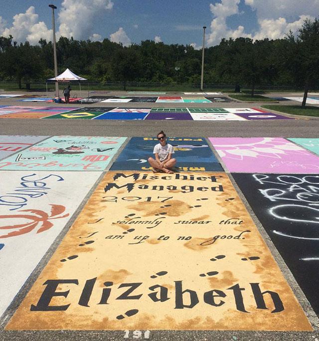 High Schools Let Their Seniors Paint Their Parking Spots (2)