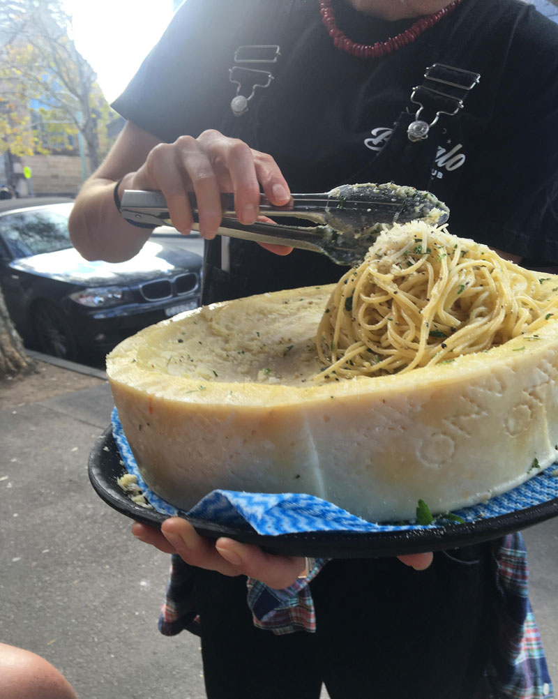 Picture of the Day: Pasta Tossed Inside a Cheese Wheel