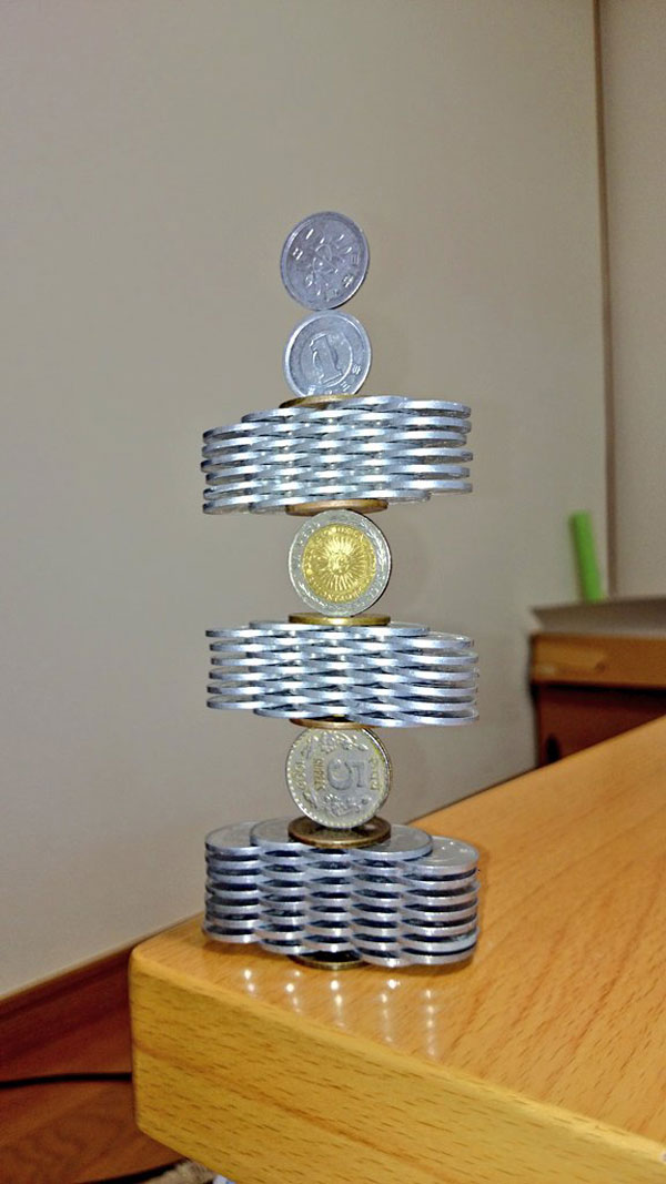 amazing coin stacking by thumb tani on twitter 11 Next Level Coin Stacking by @Thumb Tani