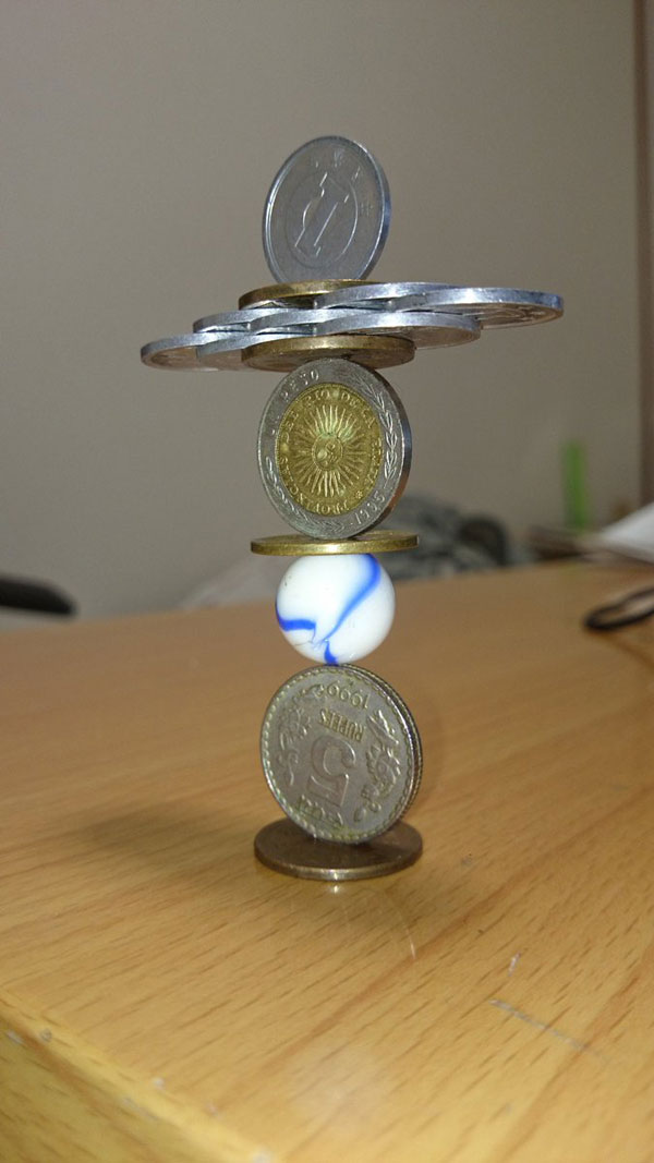 amazing coin stacking by thumb tani on twitter 23 Next Level Coin Stacking by @Thumb Tani