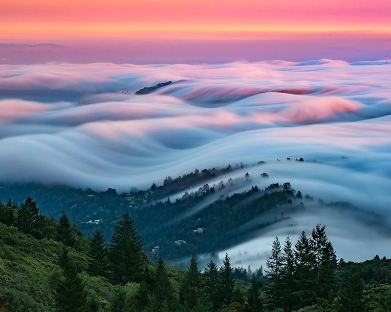 fog waves by nick steinberg 1 Photographer Captures Fog Waves That Look Like Oceans in the Sky