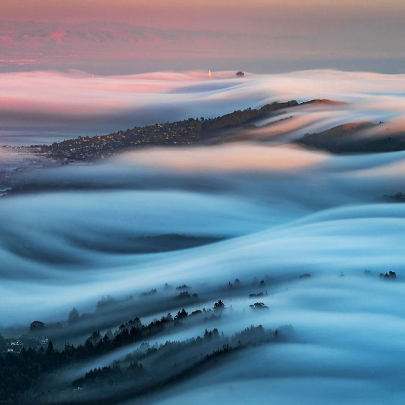fog waves by nick steinberg 2 Photographer Captures Fog Waves That Look Like Oceans in the Sky