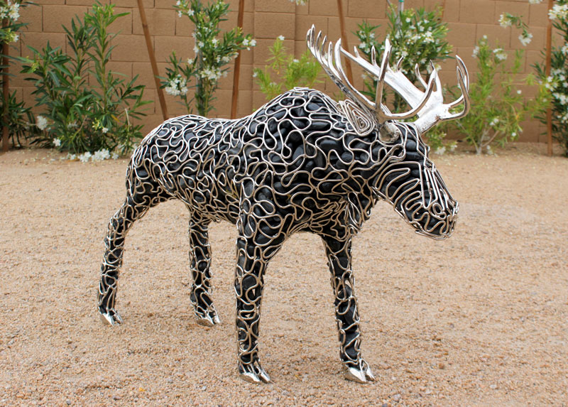 metal and river rock sculptures by ryan mccallister 7 Incredible Sculptures Made from Metal and River Rock