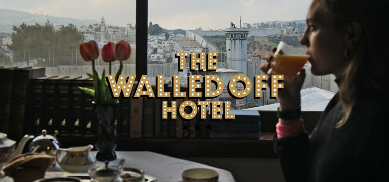 banksy walled off hotel 2 Banksy Opens Art Hotel with Worlds Worst View