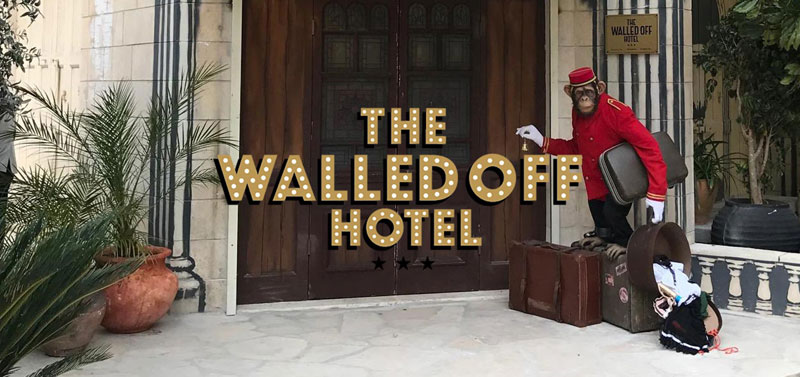 banksy walled off hotel Banksy Opens Art Hotel with Worlds Worst View