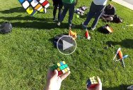 Guy Solves 3 Rubik's Cubes.. While Juggling Them