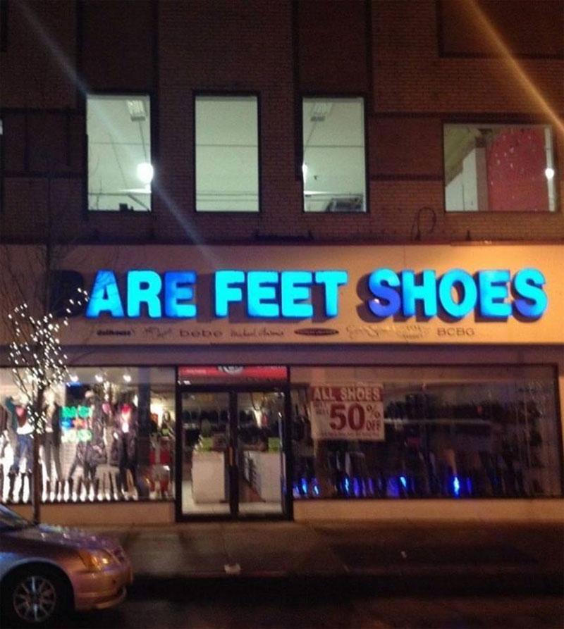 are feet shoes store sign gets philosophical Sign Burns Out and Gets All Philosophical