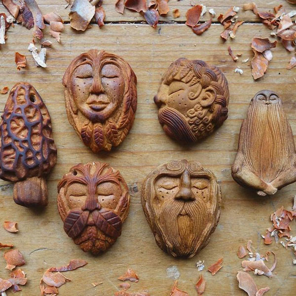 avocado stone faces carved by jan campbell 5 Waste Not, Want Not: Artist Carves Avocado Pits Into Tiny Forest Spirits