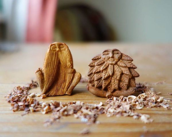 avocado stone faces carved by jan campbell 9 Waste Not, Want Not: Artist Carves Avocado Pits Into Tiny Forest Spirits