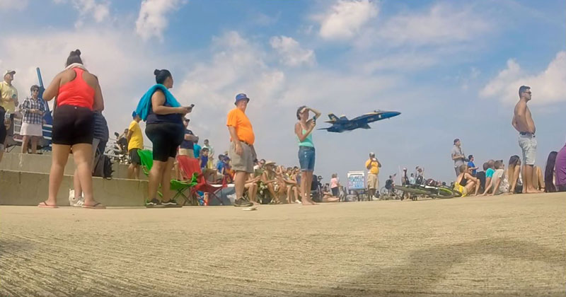 Blue Angel Sneaks Behind Crowd For Surprise Low Pass Flyby