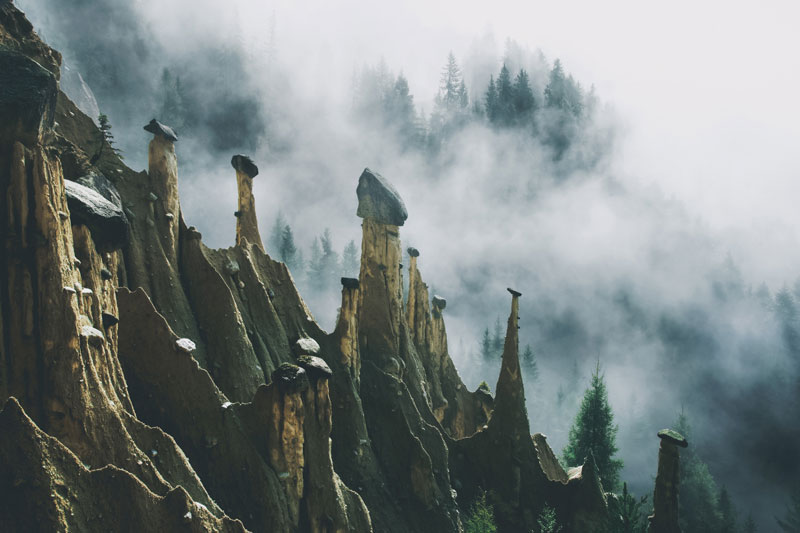 earth pyramids of south tyrol kilian schonberger otherworld 13 The Earth Pyramids of Italy: Where Boulders Perch Atop Pillars of Clay