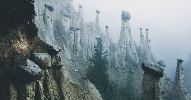 The Earth Pyramids of Italy: Where Boulders Perch Atop Pillars of Clay