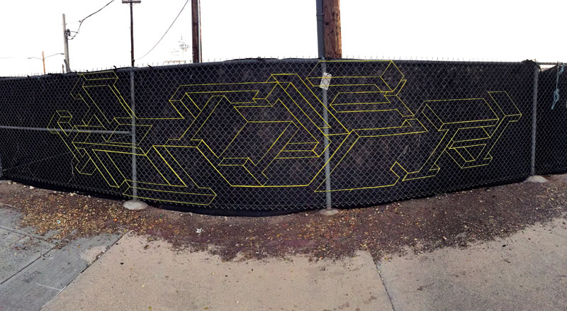 street artist hot tea yarn fence 3d letters 12 This Artist Uses Yarn to Create Amazing 3D Letters on Chain Link Fences