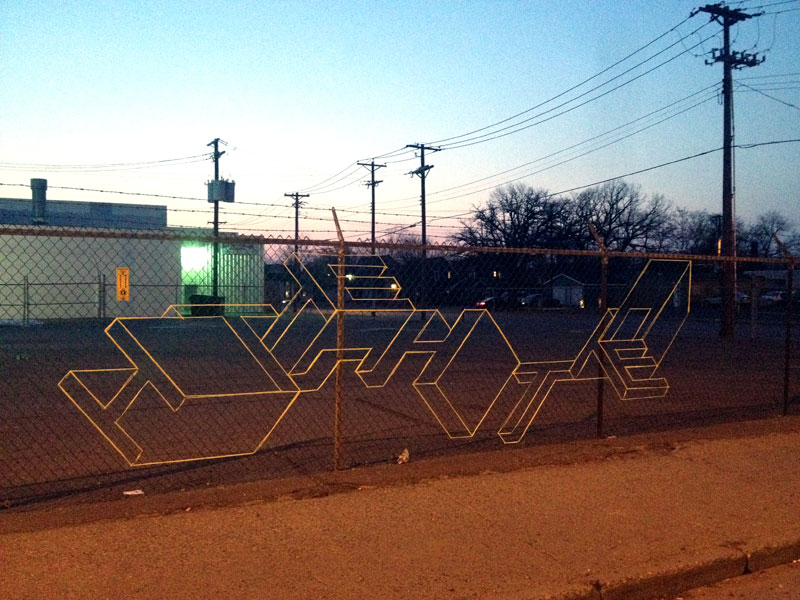 street artist hot tea yarn fence 3d letters 2 This Artist Uses Yarn to Create Amazing 3D Letters on Chain Link Fences
