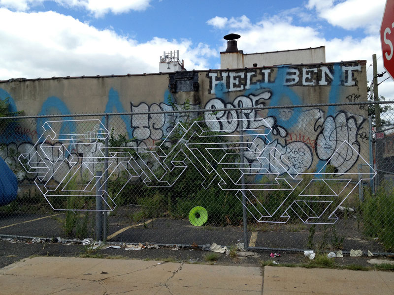 street artist hot tea yarn fence 3d letters 9 This Artist Uses Yarn to Create Amazing 3D Letters on Chain Link Fences