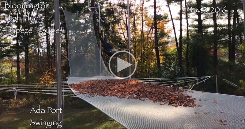 Trapeze Artist Demonstrates Principles of Inertia With Slow Motion Fall Into Leaves