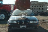 4 Ton Wrecking Ball vs Assorted Vehicles (The Slow Mo Guys)