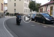 This Guy Playing Trombone on the Back of a Scooter Sounds Like He's Going 200 mph