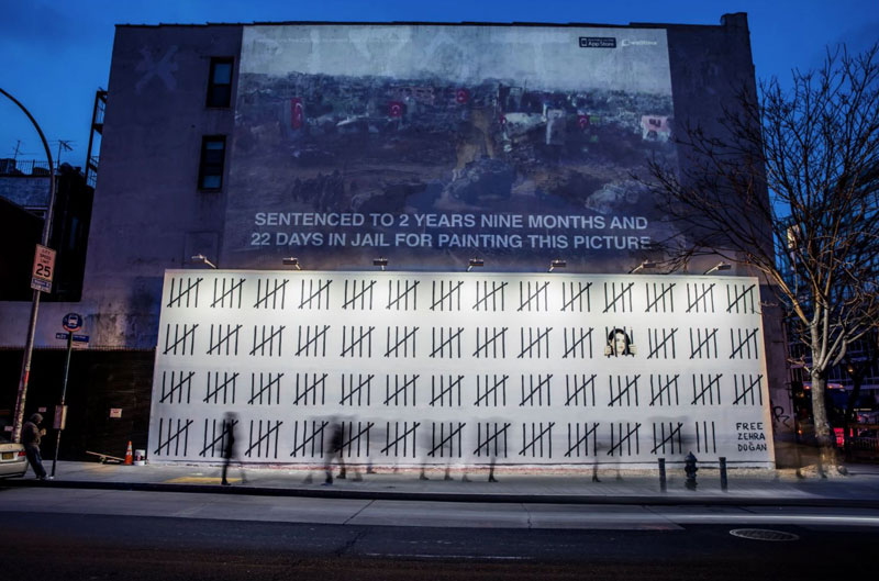 banksy protest new york 2018 free dogan New Banksys Appear in NYC, Including Giant Mural of Imprisoned Artist