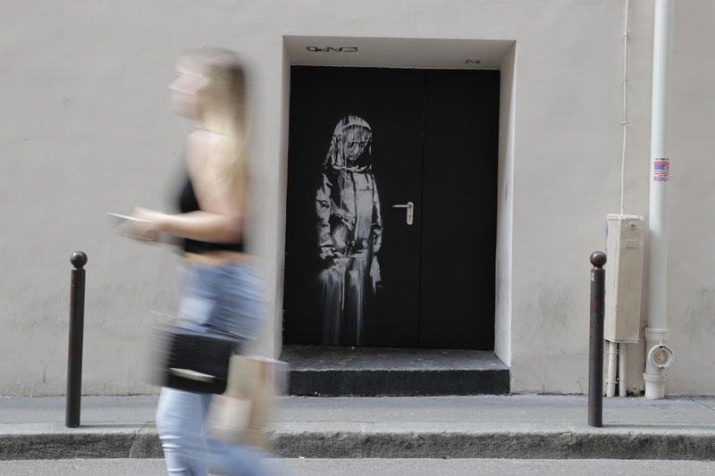 new banksy in paris france 12 Banksy Just Blitzed Paris With At Least 10 New Pieces