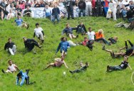 Slow Motion Wipeouts of People Chasing Cheese Down a Hill Set to Classical