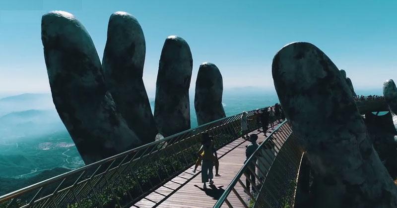 giant hands holding up golden bridge on ba na hills da nang vietnam 2 Giant Hands Raise Bridge in Vietnam to the Sky