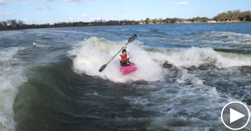 Just a Guy Kayaking Behind Two Wakeboard Boats