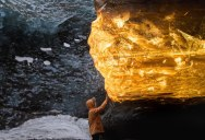 Setting Sun Turns Ice Cave in Iceland Into Amber