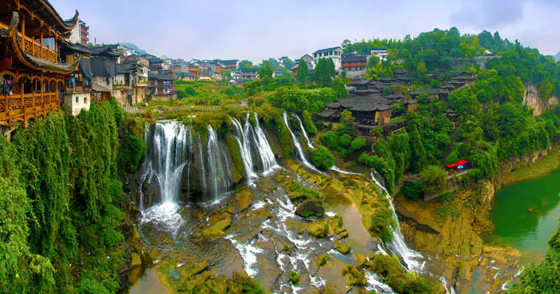 waterfall city china furong zhen town hibiscus town wang village cover This Waterfall City in China Looks Straight Out of a Fantasy Film