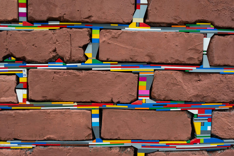 filling holes and cracks in walls with lego jan vormann 2 People Around the Globe Are Filling Cracks With LEGO (10 Photos)