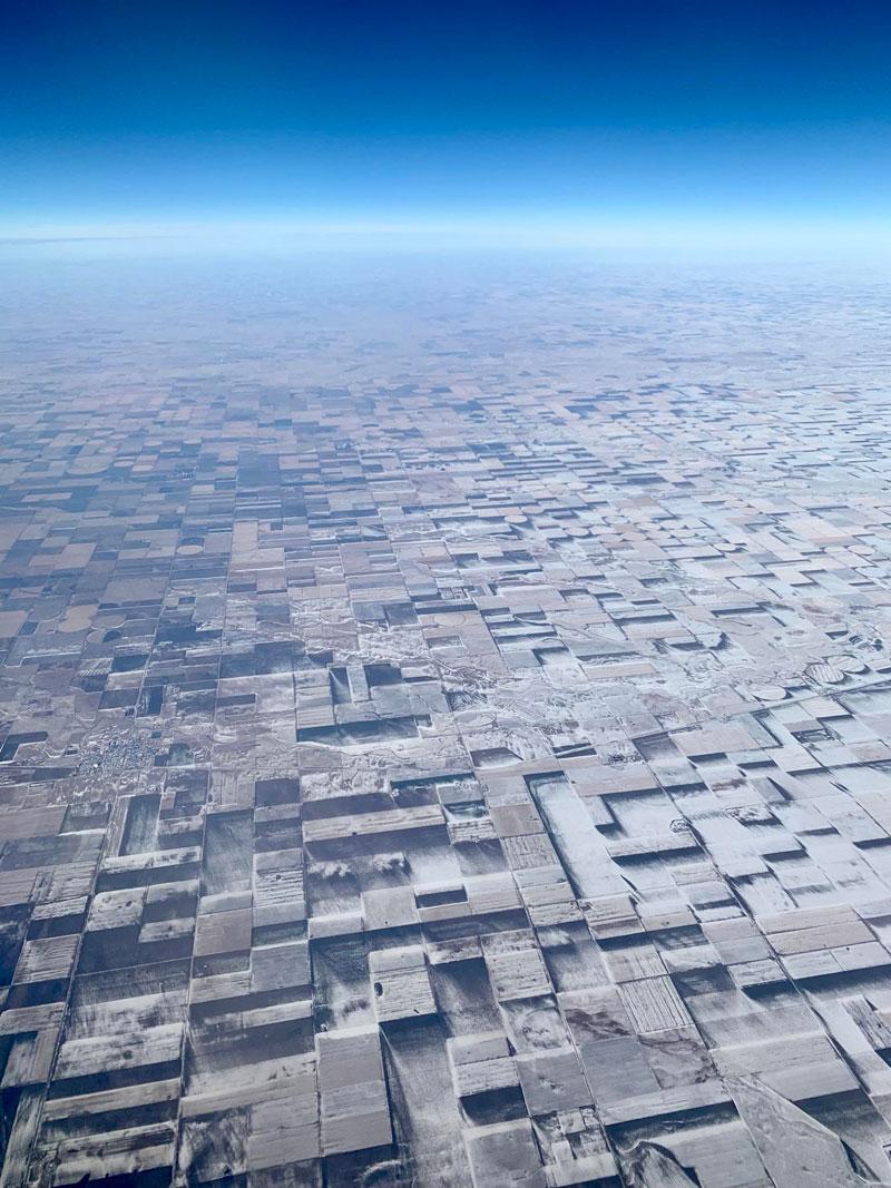 windblown snow makes flat farmland look 3d from above Windblown Snow Makes Flat Farmland Look 3D From Above