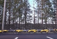 10 Robots Working Together To Pull a Giant Truck