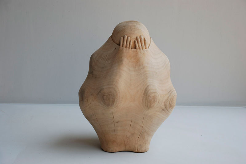 trapped in wood sculptures carved by tung ming chin 11 Trapped in Wood: Haunting Sculptures Carved by Tung Ming Chin