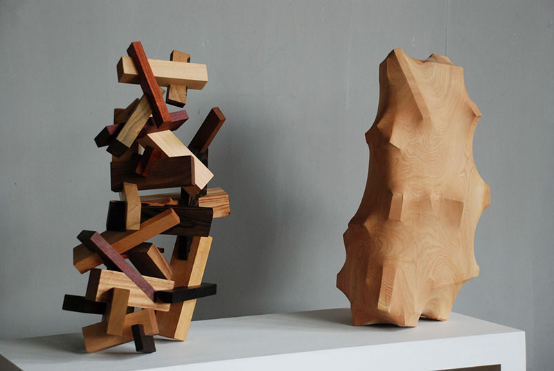 trapped in wood sculptures carved by tung ming chin 12 Trapped in Wood: Haunting Sculptures Carved by Tung Ming Chin