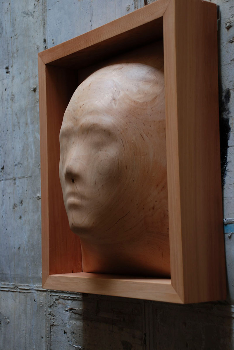 trapped in wood sculptures carved by tung ming chin 5 Trapped in Wood: Haunting Sculptures Carved by Tung Ming Chin