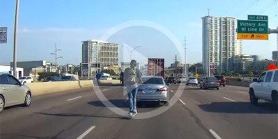 Guy on Rented Scooter Crosses 5 Highway Lanes Wearing Headphones