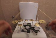 Slaying System of a Down's 'Toxicity' on a Miniature Drum Kit