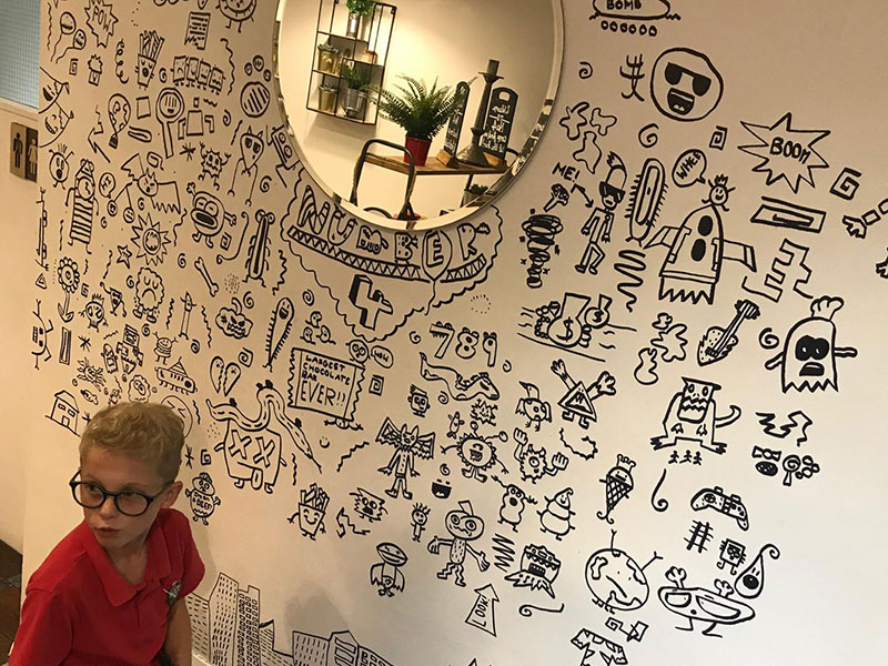 kid told not to doodle in class gets hired by local restaurant to decorate their walls 21 Kid Told Not to Doodle in Class Gets Hired by Local Restaurant to Decorate Their Walls